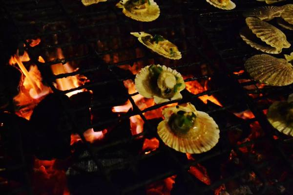 Grilling some scallops.