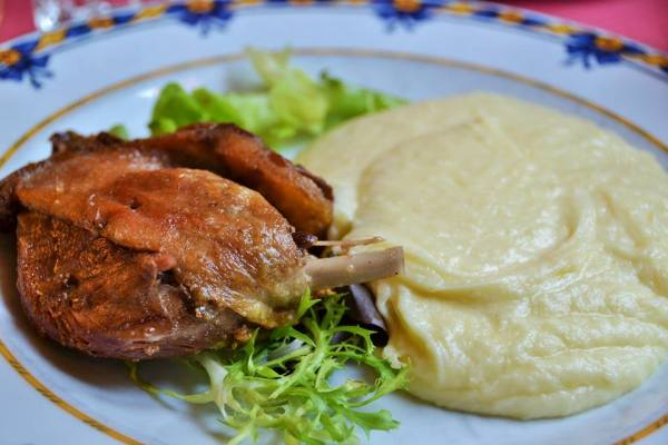 Duck confit in Paris! And that side dish is aligot, mashed potatoes and melted cheese.